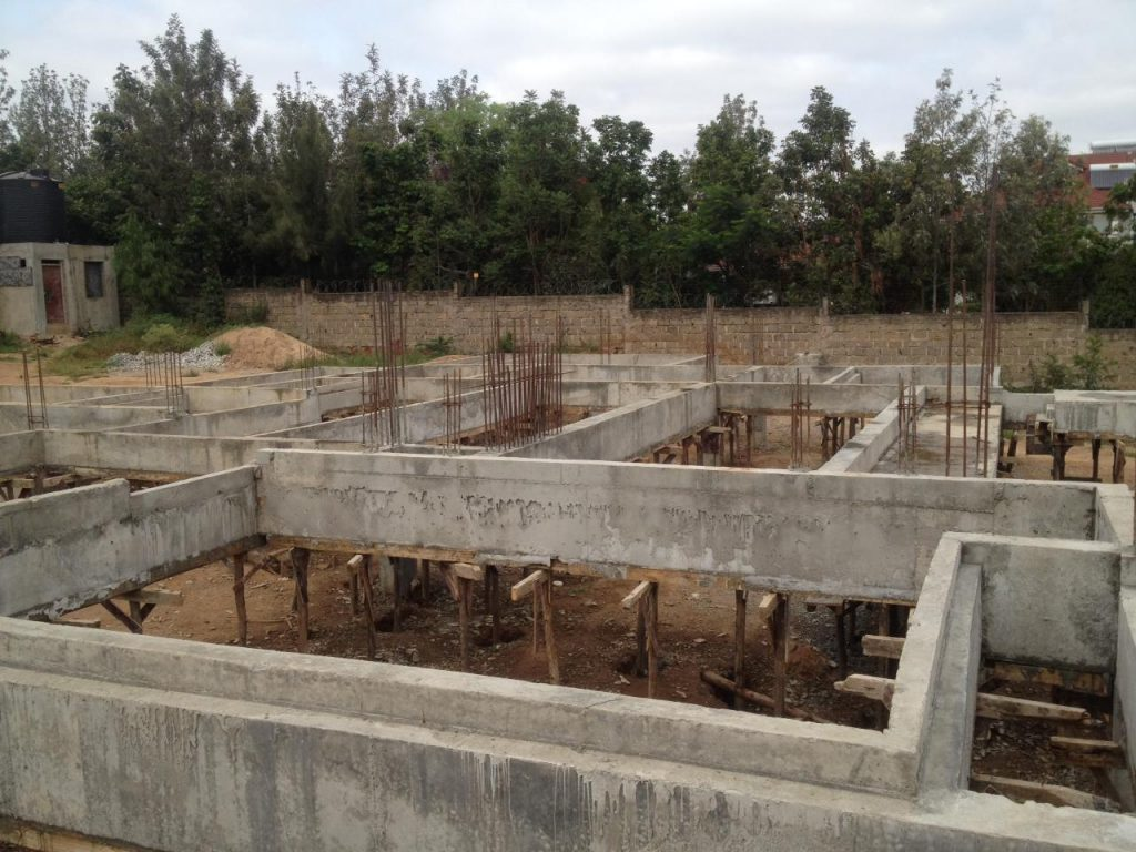 A reinforced concrete column and ring beam structure ready for the beam and block slab installation