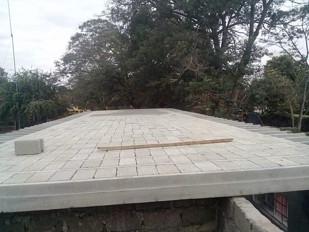 Precast beam and block flooring system
